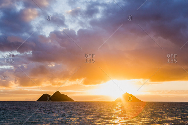 Sunset over islands in Hawaii