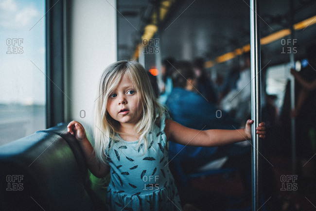 Girl on an airport shuttle train
