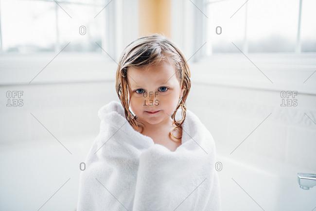 Girl wrapped in towel in bathroom
