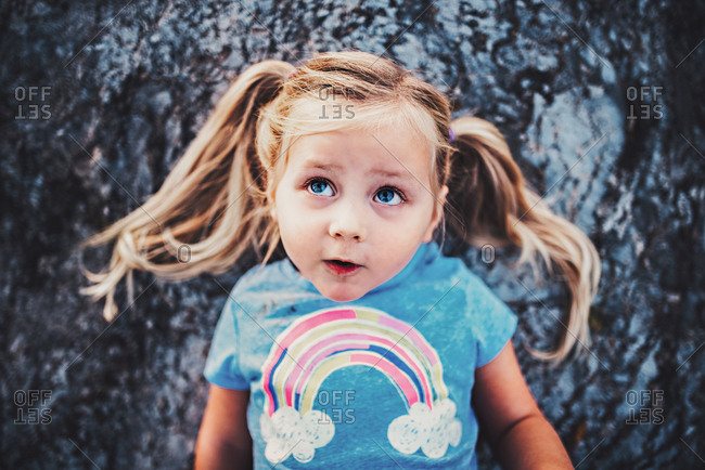 Girl in rainbow T-shirt and pigtails
