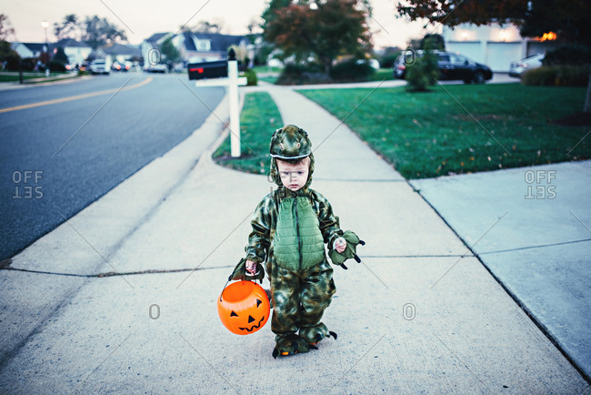 Boy in a dragon costume for Halloween