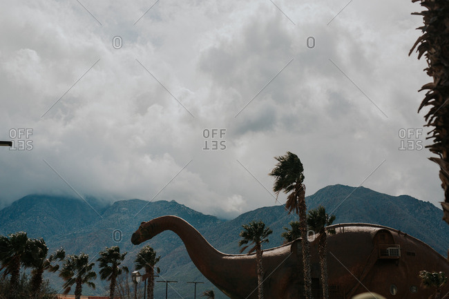 Dinosaur statue near mountains, California