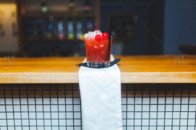 A red drink on a bar counter