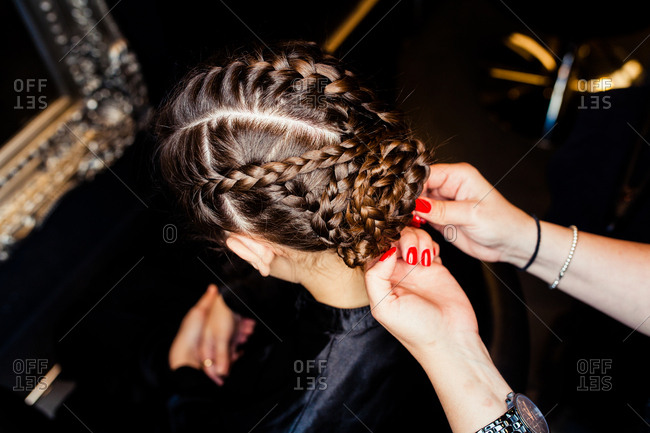 Woman getting a fancy braided hairdo