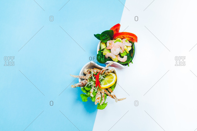 Overhead view of small plates of food