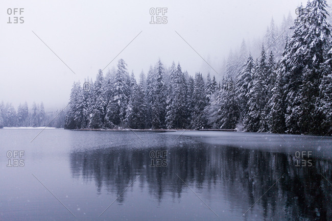 Snow falling on a lake in British Columbia