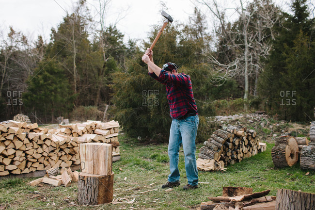 Man swinging an axe to chop firewood