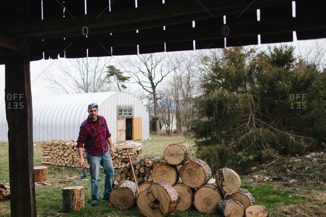 Man working to prepare firewood on a farm