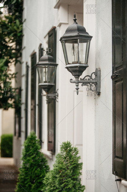 Iron lamps at the entrance to an elegant home