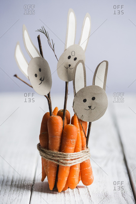 Carrots wrapped in twine with paper bunny faces
