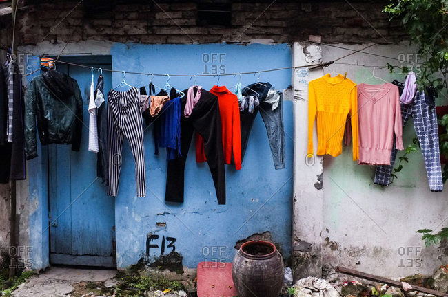 Hanoi, Vietnam - December 28, 2015: Clothes hanging to dry in yard