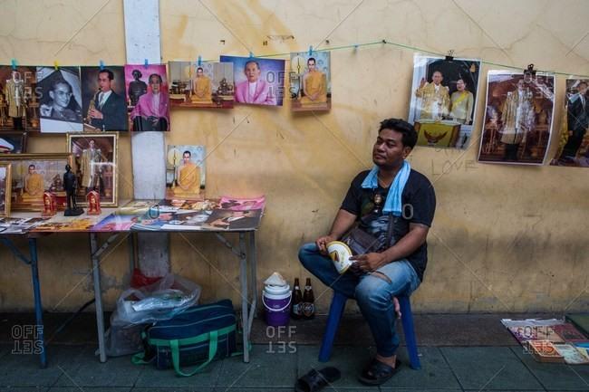Bangkok, Thailand - October 18, 2016: Man selling portraits of King Bhumibol Adulyadej