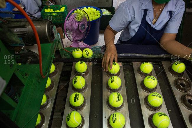 Nakhon Pathom, Thailand - August 18, 2016: Stamping tennis balls with logo