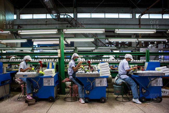 Nakhon Pathom, Thailand - August 18, 2016: Factory workers making tennis balls
