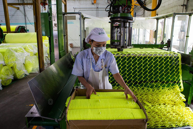 Nakhon Pathom, Thailand - August 18, 2016: Person stacking coverings for tennis balls