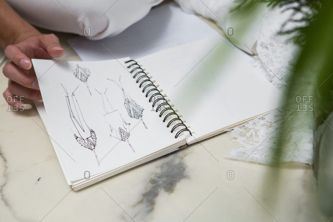 A fashion designer with sketches