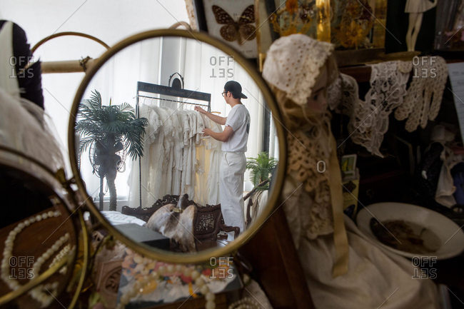 July 25, 2016: A clothing designer reflected in mirror