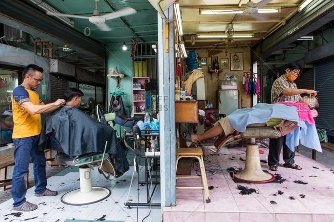 Bangkok, Thailand - July 24, 2016: Men in a local barber shop