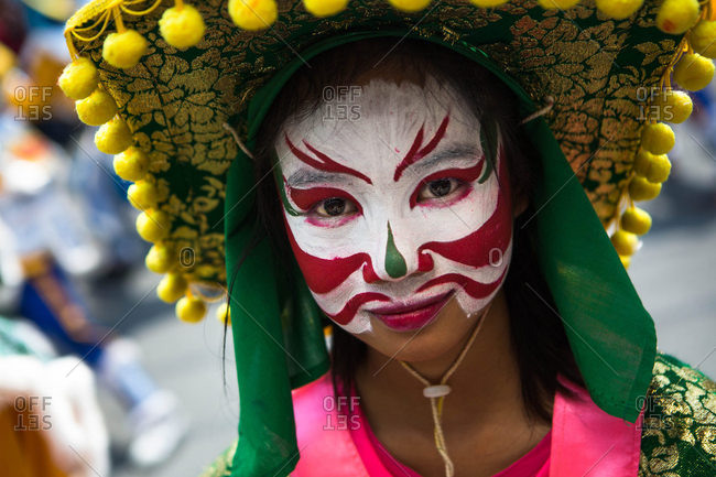 Nakhon Swan, Thailand - February 11, 2016: A woman at a Chinese New Year parade