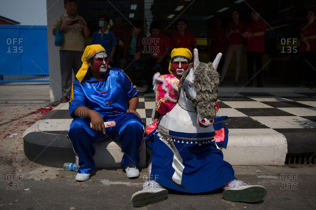 Nakhon Swan, Thailand - February 11, 2016: Performers rest at Chinese New Year parade