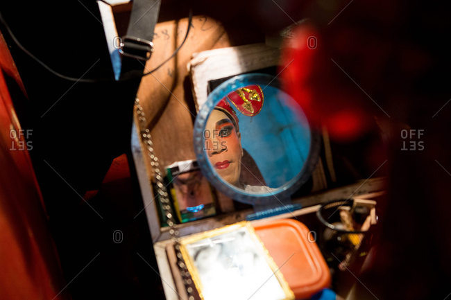 Nakhon Swan, Thailand - February 10, 2016: Theater performer reflected in mirror