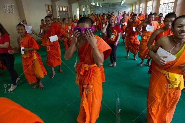 Nakhon Swan, Thailand - February 10, 2016: Young monks attend an event