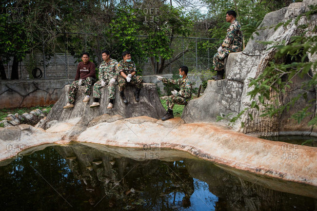 Kanchanaburi, Thailand - June 2, 2016: Wildlife officers waiting in tiger enclosure