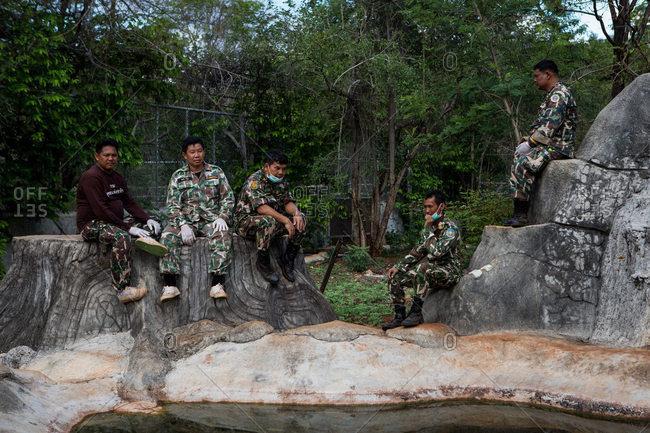 Kanchanaburi, Thailand - June 2, 2016: Wildlife officers waiting in a tiger enclosure