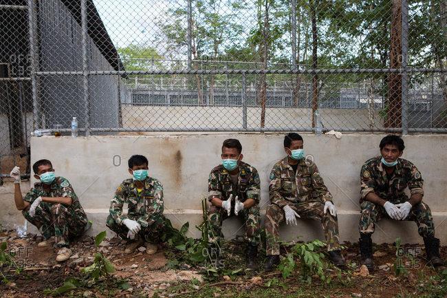 Kanchanaburi, Thailand - June 2, 2016: Wildlife officers waiting to move tiger