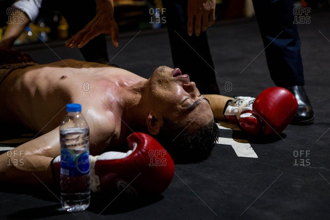 Thailand - May 13, 2016: A Muay Thai fighter on ground, Bangkok, Thailand