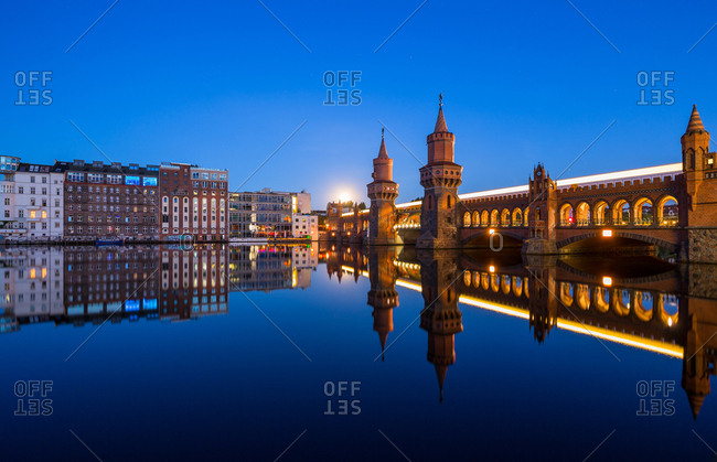Berlin, Germany - August 18, 2016: Oberbaum Bridge and cityscape reflection in the Spree river