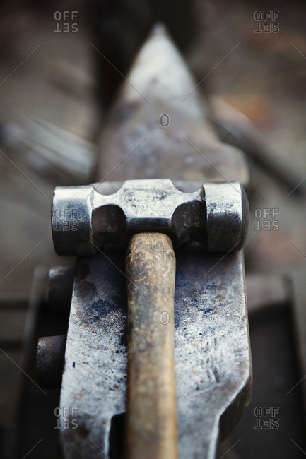 Hammer and small anvil, tools of the farrier's trade.