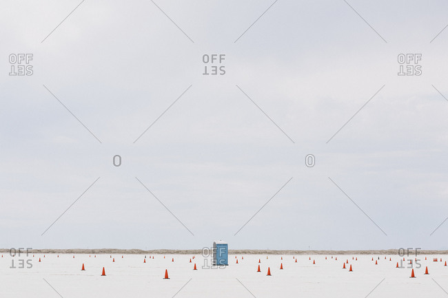 A driving course marked out with traffic cones in a desert landscape.
