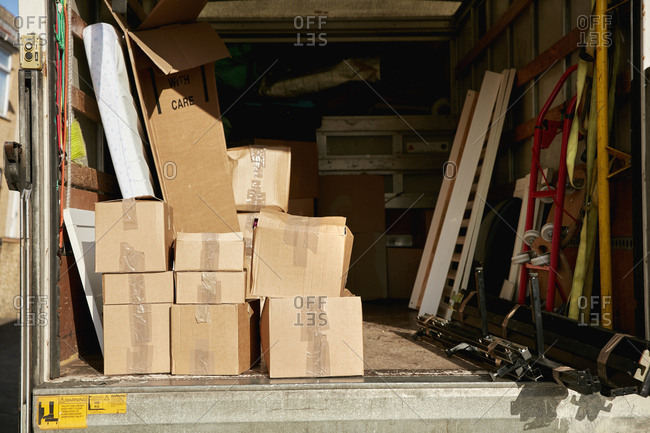 Removals business. A removals van with boxes stacked and furniture items.