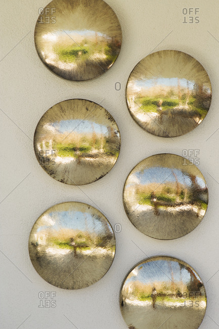 Decorative discs hanging on wall