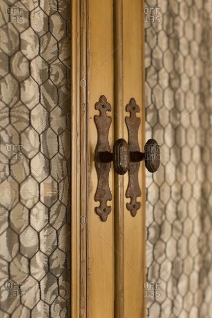 Chicken-wire lined cabinet doors