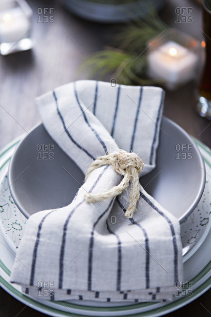 Striped napkin tied with sisal rope