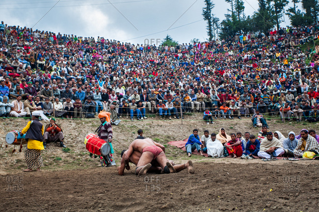 October 4, 2009 - Shimla, India: Spectators watch wrestlers at festival