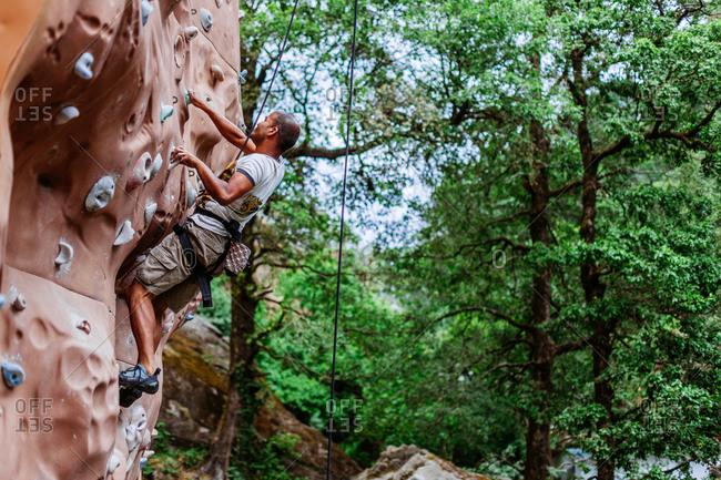 May 30, 2013 - Nainital, Uttarakhand, India: Man practices on outdoor climbing wall