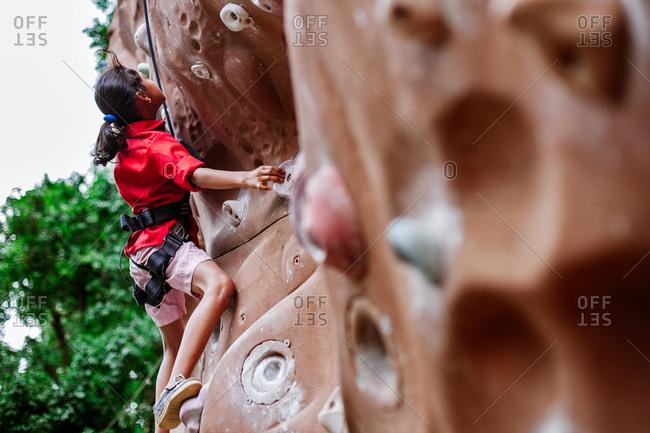May 30, 2013 - Nainital, Uttarakhand, India: Young woman practicing on outdoor climbing wall