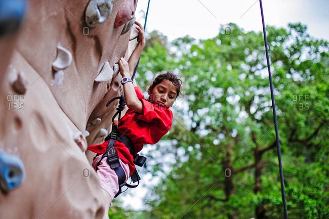 May 30, 2013 - Nainital, Uttarakhand, India: View of woman practicing on climbing wall