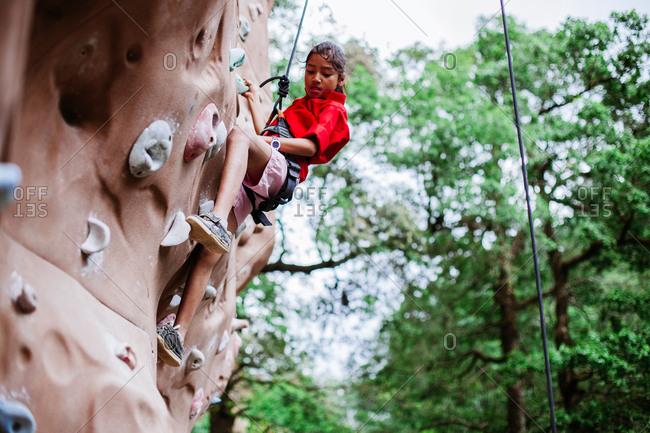 May 30, 2013 - Nainital, Uttarakhand, India: Climber in harness practices on outdoor climbing wall