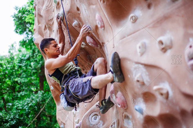 May 30, 2013 - Nainital, Uttarakhand, India: Climber concentrating on his handholds