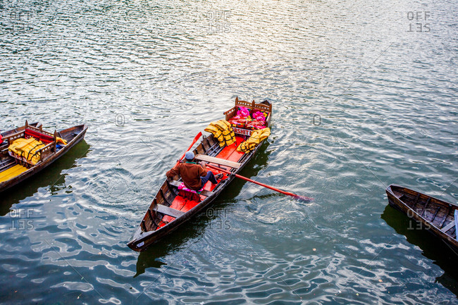 May 30, 2013 - Nainital, Uttarakhand, India: Man rowing boat in lake