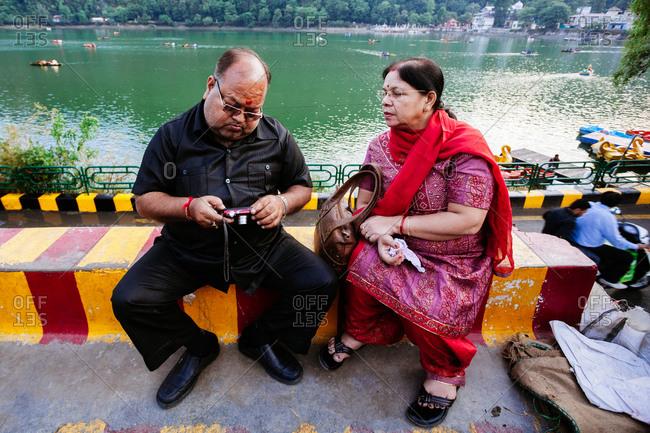 May 30, 2013 - Nainital, Uttarakhand, India: Woman watches as man checks digital camera