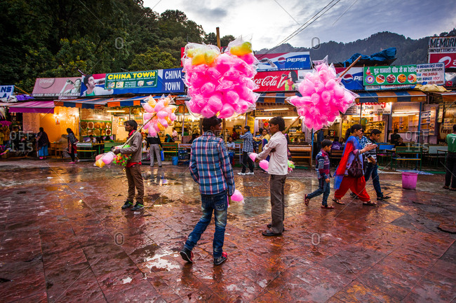 May 30, 2013 - Nainital, Uttarakhand, India: Cotton candy vendors at street market