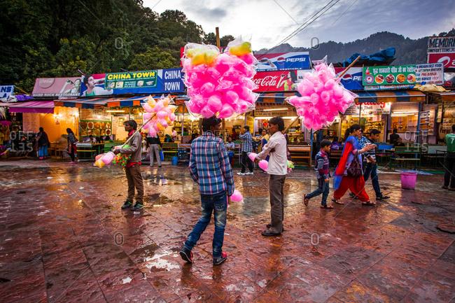 May 30, 2013 - Nainital, Uttarakhand, India: Cotton candy vendors at street market