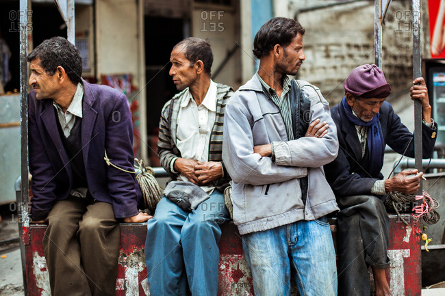June 9, 2013 - Nainital, Uttarakhand, India: Men sitting on street corner