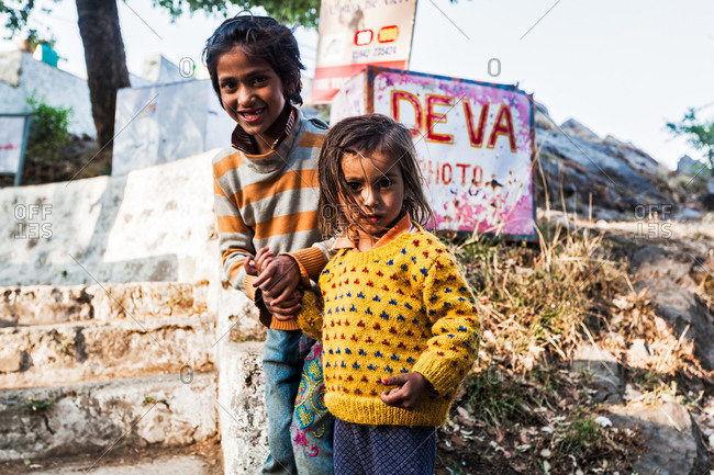 May 29, 2013 - Nainital, Uttarakhand, India: Two young children standing near signs