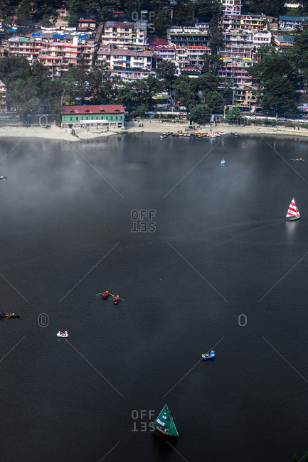 June 10, 2013 - Nainital, Uttarakhand, India: Boats and buildings on Lake Kumaon